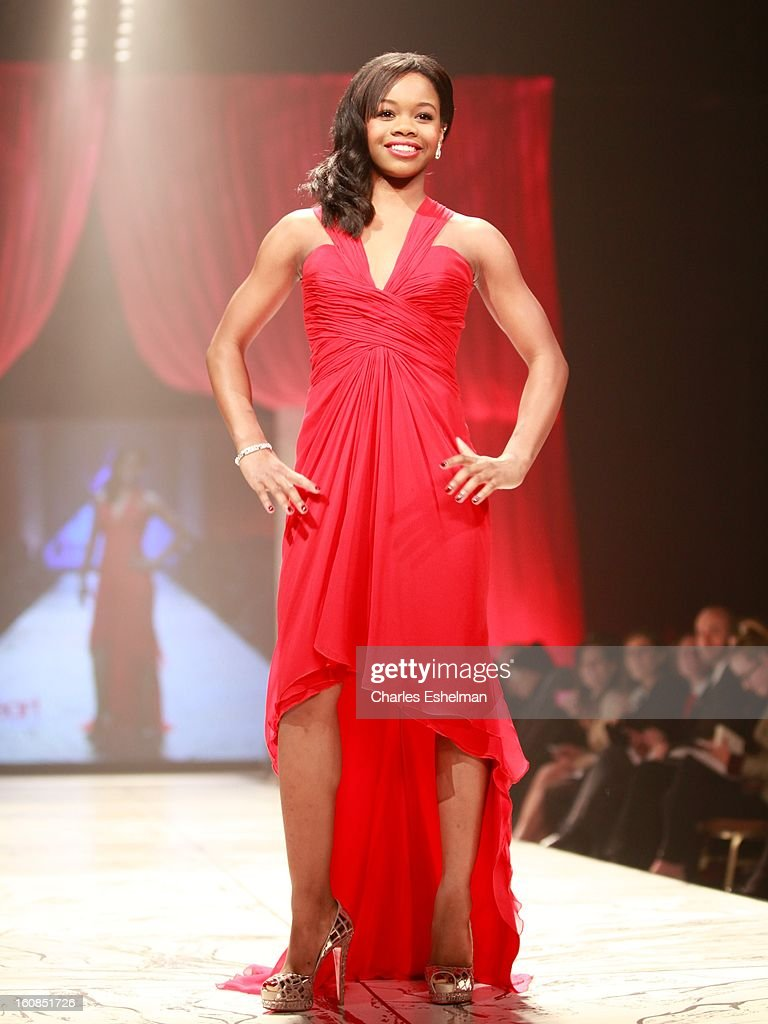 Gymnast Gabrielle Douglas walks the runway at The Heart Truth's Red Dress Collection Fall 2013 Mercedes-Benz Fashion Show at 499 Seventh Avenue on February 6, 2013 in New York City.