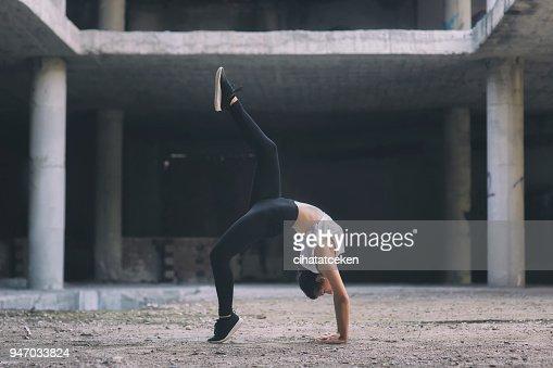Gymnast girl acting on the street : Stock Photo