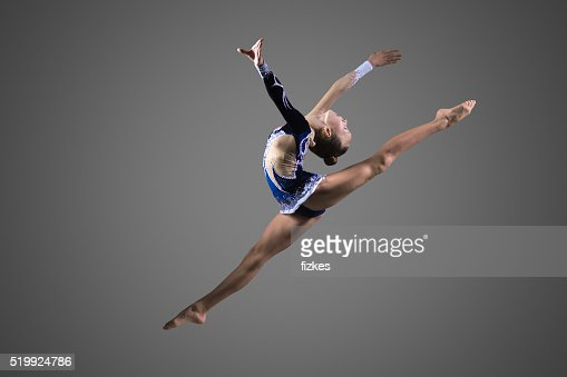 Gymnast girl doing splits in the air : Stock Photo