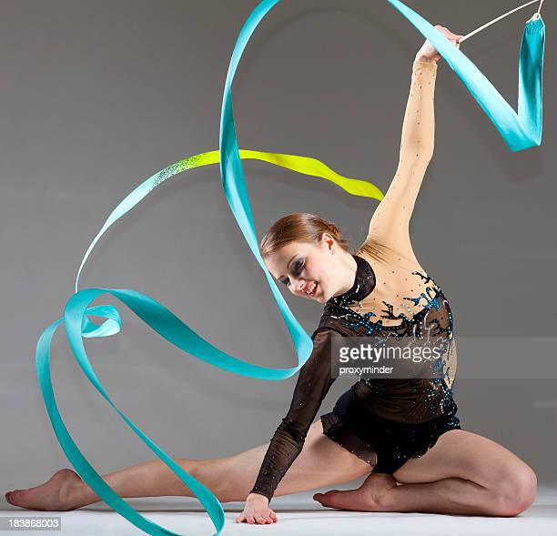 Gymnast girl on grey background