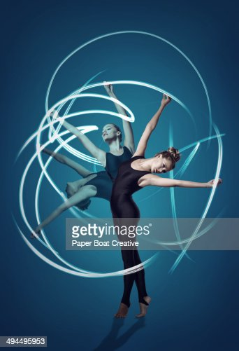 Gymnast in 3 split second motions, with light rays : Foto stock