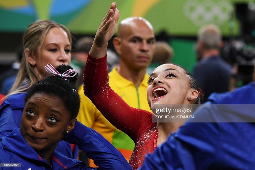TOPSHOT - US gymnast Lauren Hernandez reacts during the women's balance beam event final of the Artistic Gymnastics at the Olympic Arena during the Rio 2016 Olympic Games in Rio de Janeiro on August 15, 2016. / AFP / Toshifumi KITAMURA