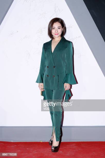 Gymnast Liu Xuan poses on the red carpet of 2017 Huanqiu Charity Fashion Ceremony on December 5 2017 in Beijing China
