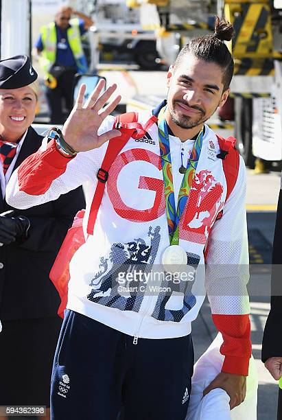 Gymnast Louis Smith wears his silver medal after arriving home at Heathrow Airport on August 23 2016 in London England The 2016 British Olympic Team...