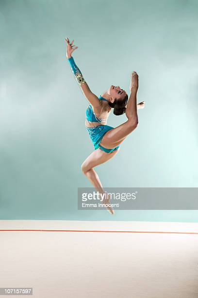 gymnast,  mid air, bending backward, arm up