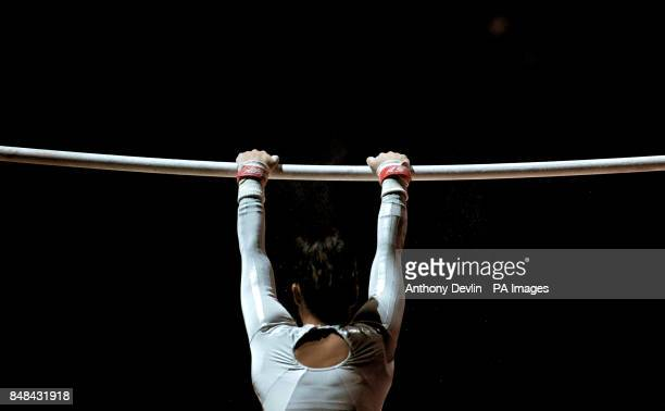 A gymnast mounts the uneven bars during the Artistic Gymnastics at the North Greenwich Arena London