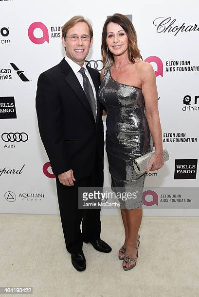 Gymnast Nadia Comaneci and Bart Conner attend the 23rd Annual Elton John AIDS Foundation Academy Awards Viewing Party on February 22 2015 in Los...
