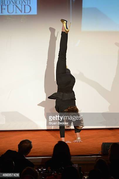 Gymnast Nadia Comaneci does a handstand onstage at the 29th Annual Great Sports Legends Dinner to benefit The Buoniconti Fund to Cure Paralysis at...