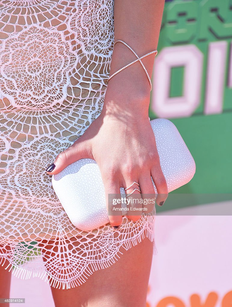 Gymnast Nastia Liukin (clutch detail) arrives at the Nickelodeon Kids' Choice Sports Awards 2014 on July 17, 2014 in Los Angeles, California.