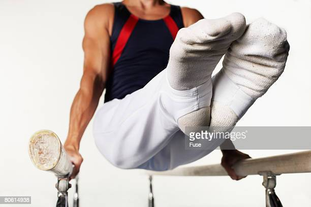 Gymnast on Parallel Bars with Feet Up