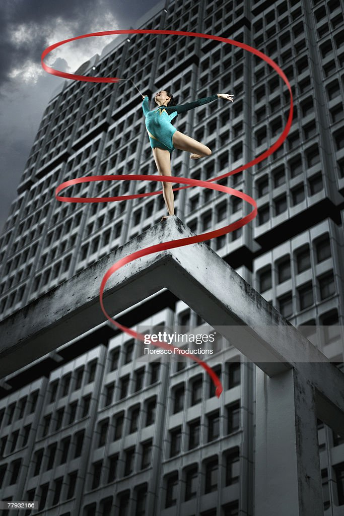 Gymnast on top of structure with ribbon : Stock Photo