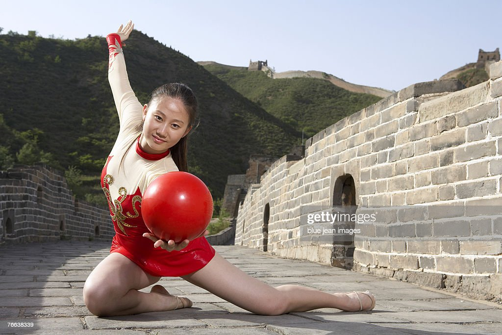 A gymnast practicing on the Great Wall of China. : Stock Photo