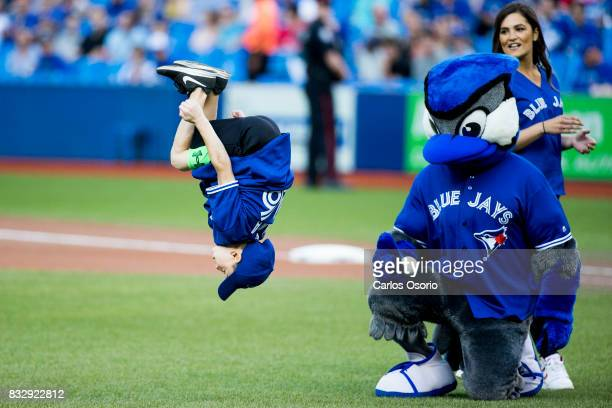 TORONTO ON AUGUST Gymnast Samuel Rakita flips before throwing out the ceremonial first pitch before the Toronto Blue Jays host the Tampa Bay Rays at...
