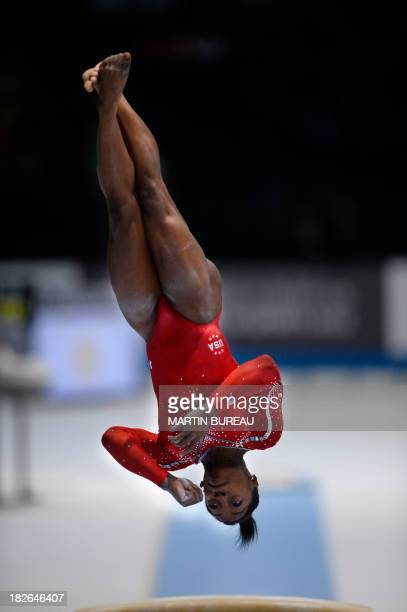 US gymnast Simone Biles competes in the vault qualifications at the 44th Artistic Gymnastics World Championships in Antwerp on October 2 2013 AFP...