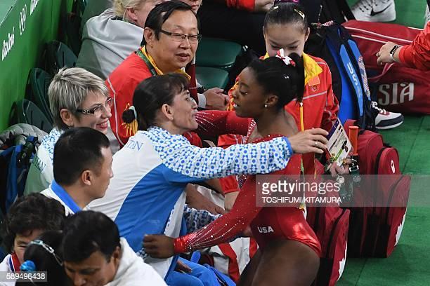 US gymnast Simone Biles is congratulated by Uzbekistan's Oksana Chusovitina after the women's vault event final of the Artistic Gymnastics at the...