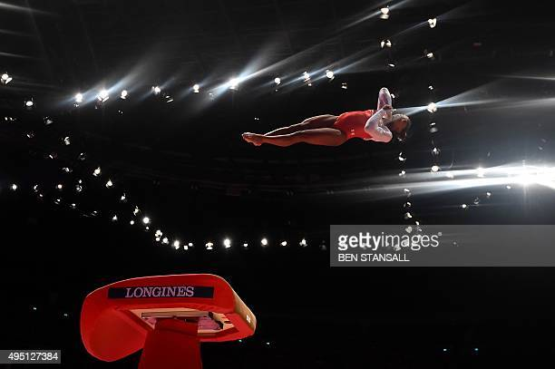 US gymnast Simone Biles performs during the Women's vault final at the 2015 World Gymnastics Championship on October 31 2015 in Glasgow Gymnasts can...