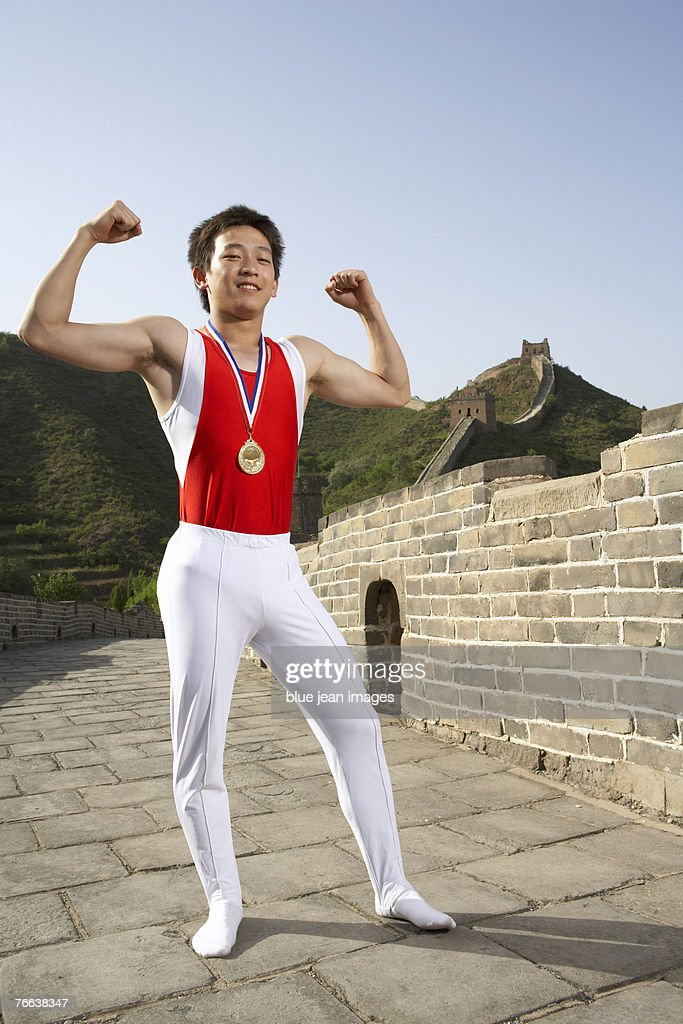 A gymnast standing on the Great Wall of China. : Stock Photo