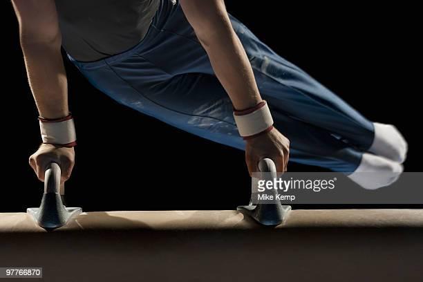 Gymnast swinging on pommel horse