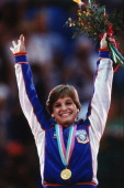 Gymnastics 1984 Summer Olympics Closeup of USA Mary Lou Retton victorious with gold medal after winning Women's AllAround competition at Pauley...