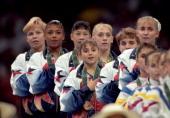 1996 Summer Olympics Team USA Amanda Borden Dominique Dawes Amy Chow Dominique Moceanu Jaycie Phelps Kerri Strug and Shannon Miller victorious on...