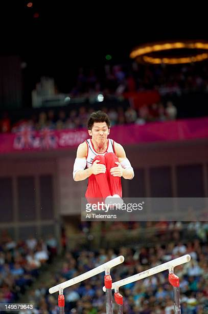 2012 Summer Olympics Japan Kazuhito Tanaka in action parallel bars during Men's Team AllAround Final at North Greenwich Arena Japan wins silver...