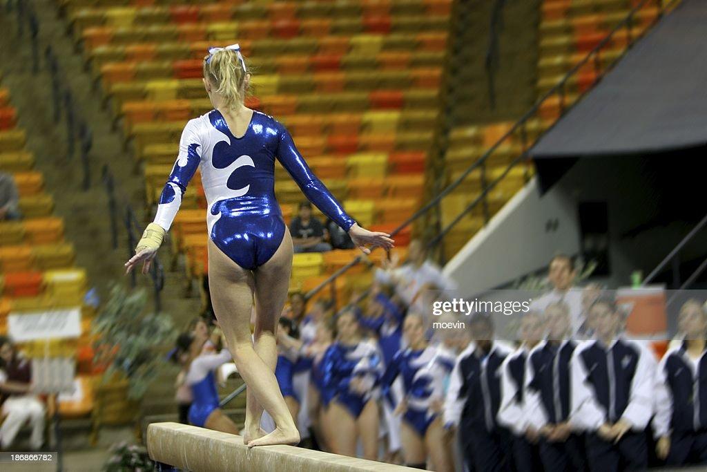 gymnastics balance beam blue leotard stock photo