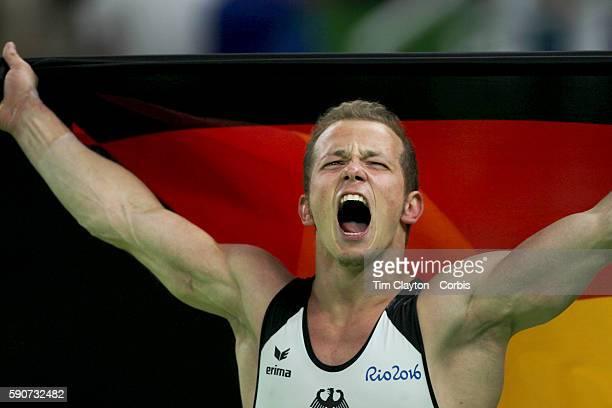 Day 11 Fabian Hambuechen of Germany celebrates after winning the gold medal in the Men's Horizontal Bar Final during the Apparatus Finals at the Rio...