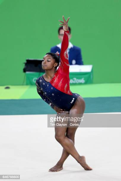 Day 2 Simone Biles of the United States performing her Floor routine during the Artistic Gymnastics Women's Team Qualification round at the Rio...