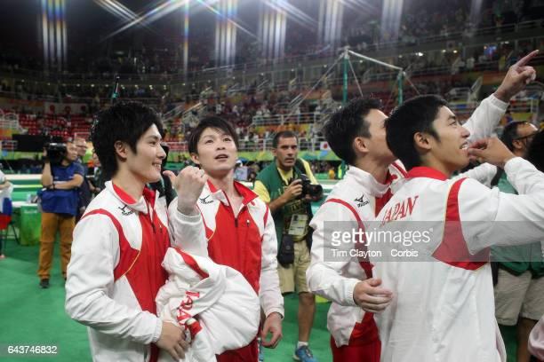 Day 3 The Japanese team of Kohei Uchimura Ryohei Kato Kenzo Shirai Koji Yamamuro and Yusuke Tanaka celebrate victory after winning the gold medal in...