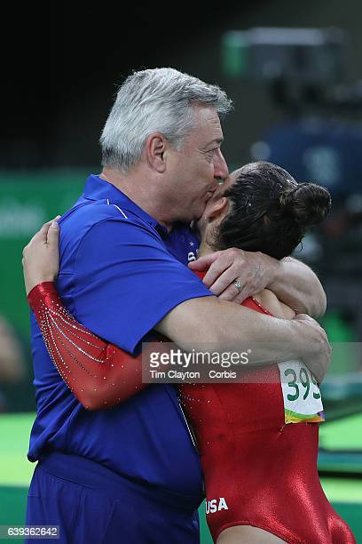 Day 6 Alexandra Raisman of the United States is embraced by her coach Mihai Brestyan after her Floor Exercise during her silver medal performance in...