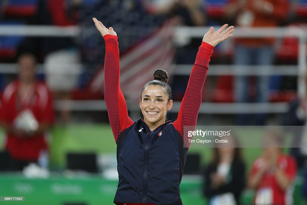 Day 6 Alexandra Raisman of the United States on the podium before receiving her silver medal during the Artistic Gymnastics Women's Individual...