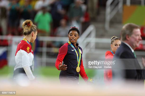 Day 9 Gold medal winner Simone Biles of the United States with silver medalist Maria Paseka of Russia and bronze medalist Giulia Steingruber of...
