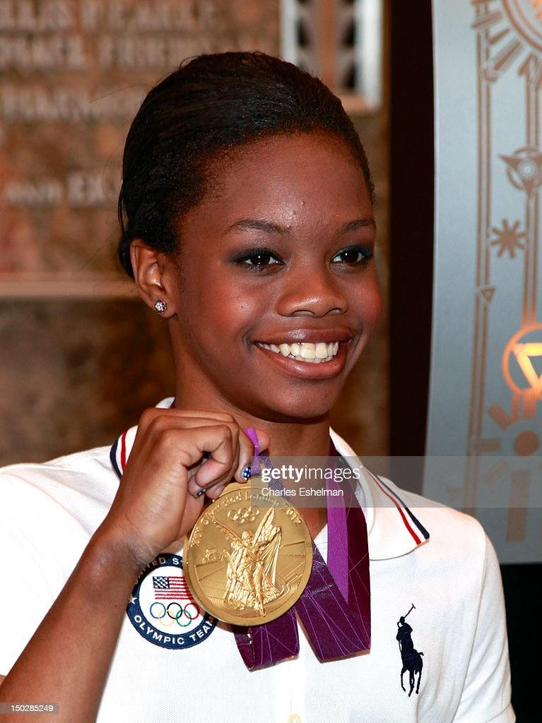 Gymnastics Team gold medalist Gabby Douglas lights The Empire State Building on August 14 2012 in New York City