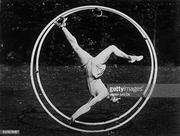 Gymnastics wheel Woman doing exercises in a gymnastics wheel 1928 Photographer Schlochauer Published by 'BZ' Vintage property of ullstein bild
