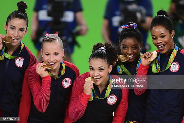US gymnasts Alexandra Raisman Madison Kocian Lauren Hernandez Simone Biles and Gabrielle Douglas celebrate with their gold medals on the podium...