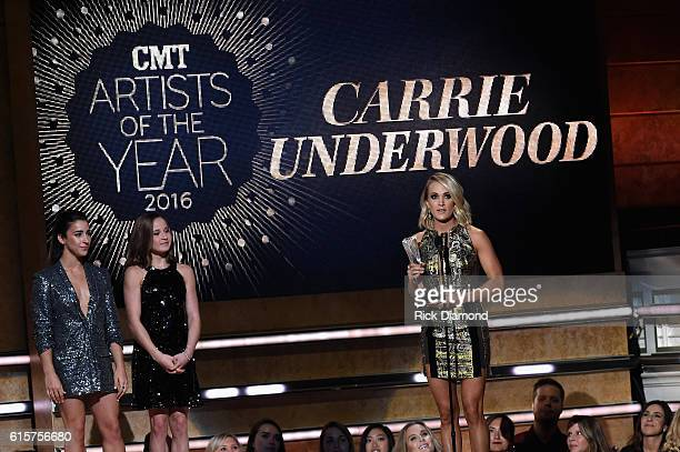 Gymnasts Aly Raisman and Madison Kocian present an award on stage to Carrie Underwood at CMT Artists of the Year 2016 on October 19 2016 in Nashville...