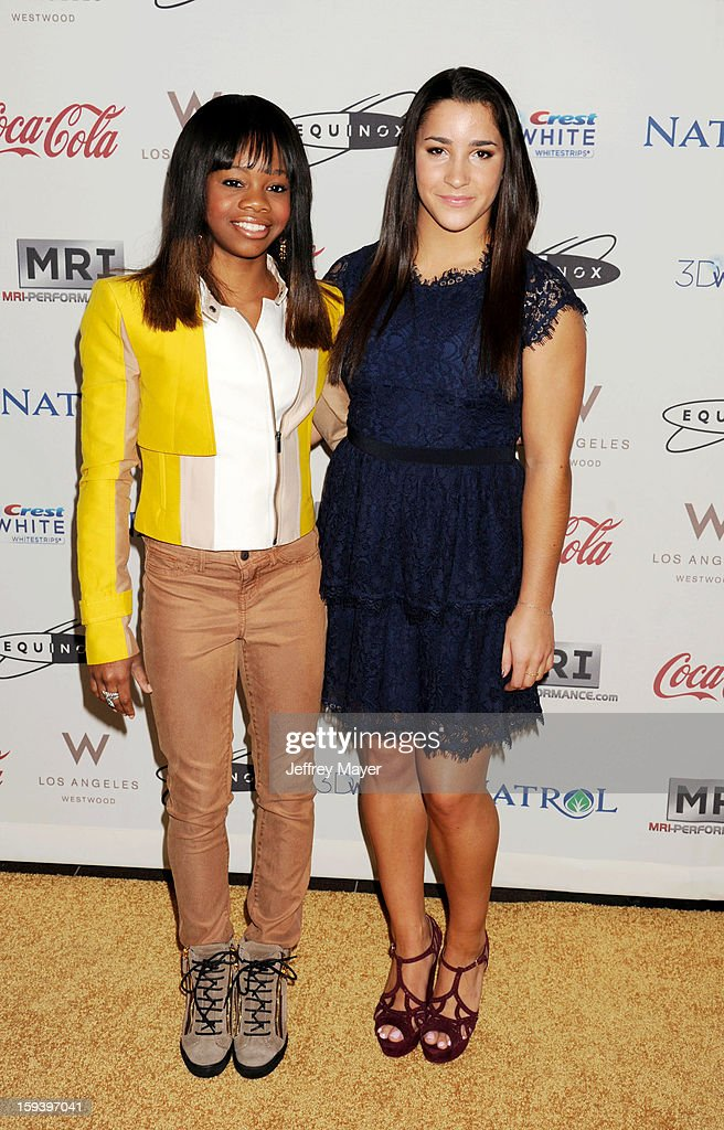 Gymnasts <a gi-track='captionPersonalityLinkClicked' href=/galleries/search?phrase=Gabby+Douglas&family=editorial&specificpeople=8465211 ng-click='$event.stopPropagation()'>Gabby Douglas</a> and Aly Raisman arrive at CW3PR Presents the inaugural 'Gold Meets Golden' event at New Equinox Flagship on January 12, 2013 in Los Angeles, California.