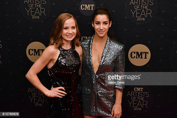 Gymnasts Madison Kocain and Aly Raisman arrive at 2016 CMT Artists of the Year at Schermerhorn Symphony Center on October 19 2016 in Nashville...