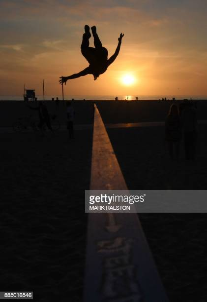 Gymnasts practice on a slackline at the original Muscle Beach in Santa Monica California on December 3 2017 The original Muscle Beach was established...