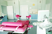 Gynecological chair in gynecological room.