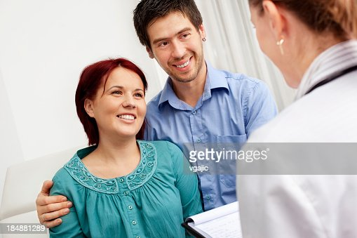 Gynecologist Talking To Pregnant Woman and her husband : Stock Photo