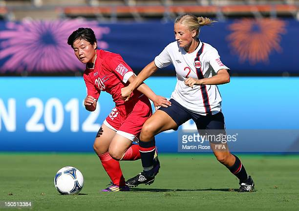 Gyong Su Kim of Korea DPR and Anja Sonstevold of Norway battle for the ball during the FIFA U20 Women's World Cup 2012 group C match between Korea...