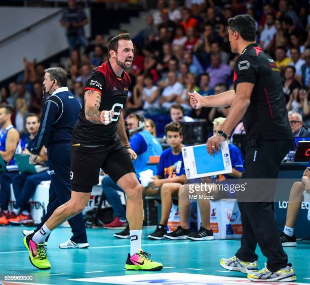 Gyorgy Grozer of Germany and Germany head coach Andrea Giani during the European Men's Volleyball Championships 2017 match between Germany and Italy...