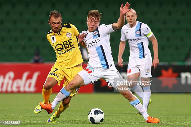 Gyorgy Sandor of the Glory and Jacob Melling of Melbourne contest for the ball during the FFA Cup Semi Final match between Perth Glory and Melbourne...