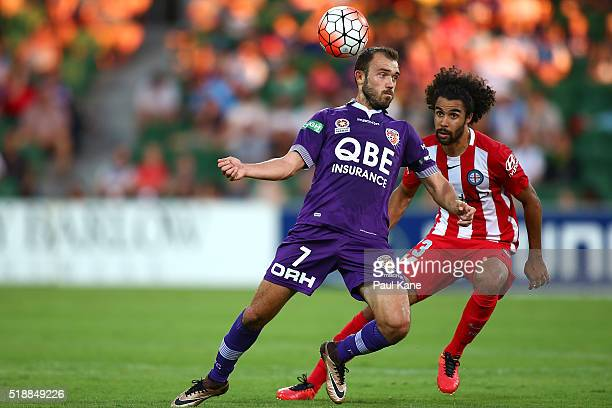 Gyorgy Sandor of the Glory heads the ball against Osama Malik of Melbourne during the round 26 ALeague match between the Perth Glory and Melbourne...