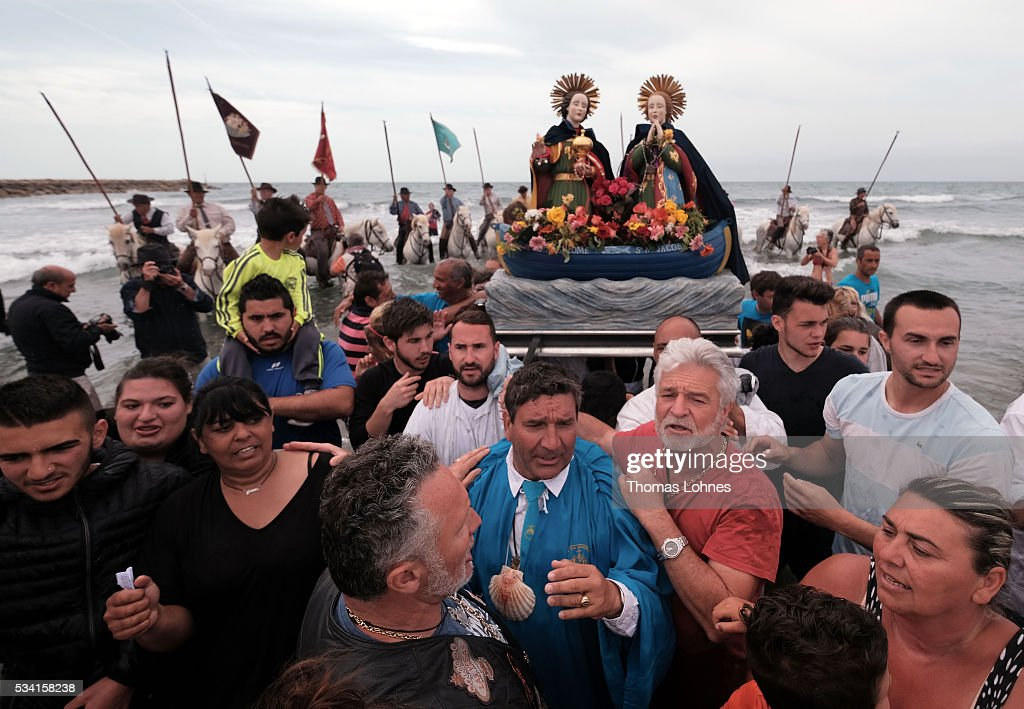 Gypsies and local members of the church carry the sculpture ot Virgin Mary to the sea on May 25, 2016 in Saintes-Maries-de-la-Mer near Arles, France. Gypsies from all over Europe worship 'Sara the Black', their Saint and patroness, for one week. Sara's statue is situated in the crypt of the church.