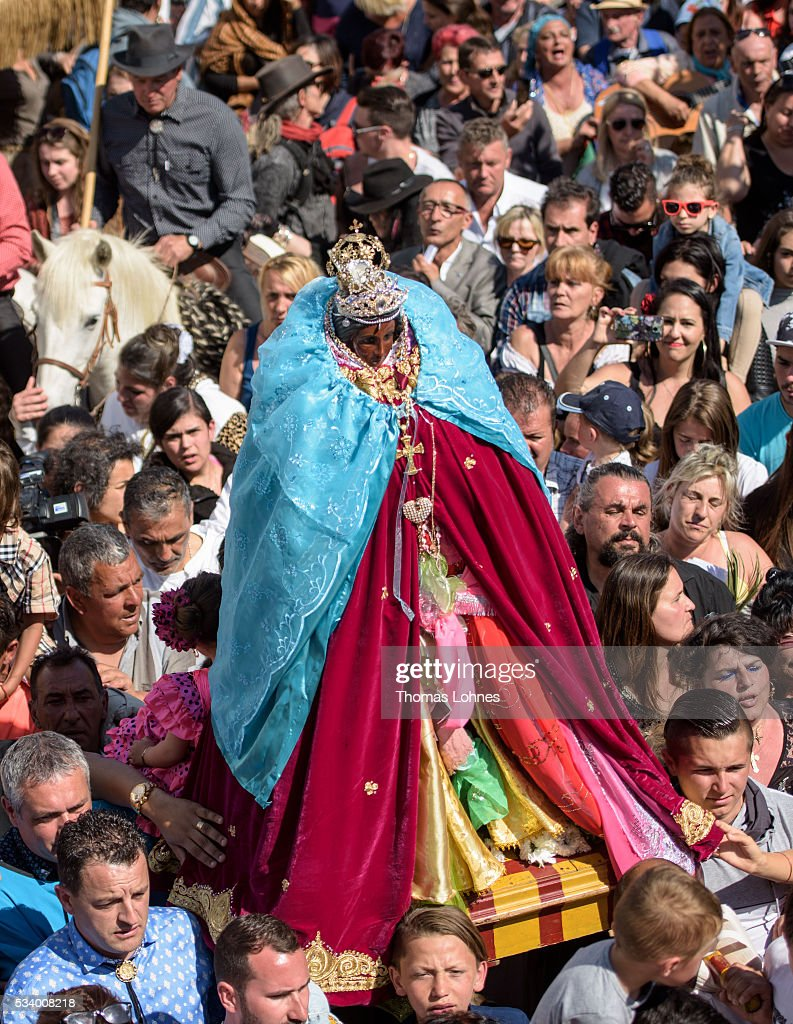 Gypsies carry the sculpture of 'Sara the Black' after in a procession to the sea on May 24, 2016 in Staintes Maries de la Mere near Arles, France. Gypsies from all over Europe worship 'Sara the Black', their Saint and patroness, for one week. Sara's statue is situated in the crypt of the church.