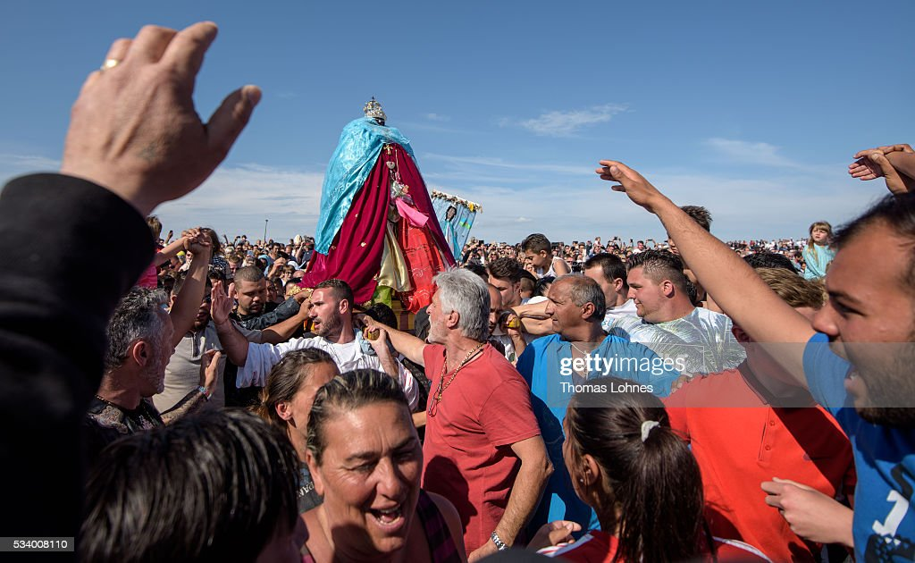 Gypsies carry the sculpture of 'Sara the Black' to the sea after a church service and a procession on May 24, 2016 in Staintes Maries de la Mere near Arles, France. Gypsies from all over Europe worship 'Sara the Black', their Saint and patroness, for one week. Sara's statue is situated in the crypt of the church.