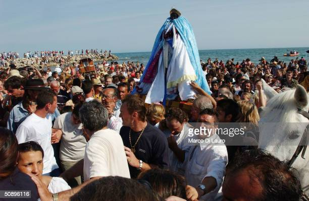 Gypsies carry the statue of Saint MarieJacob and Saint MarieSalom to the sea in Saintes Maries de la Mer in the Camargue region of Southern France on...