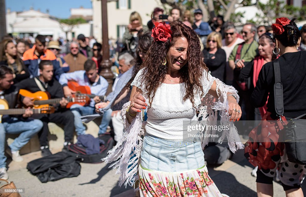 Gypsies dance in front of church on May 24, 2016 in Staintes Maries de la Mere near Arles, France. Gypsies from all over Europe worship 'Sara the Black', their Saint and patroness, for one week. Sara's statue is situated in the crypt of the church. She wears a multicoloured dress and will carried by the gypsies to the sea at this afternoon.